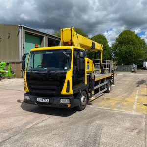 Yellow Truck Mounted picker front and left