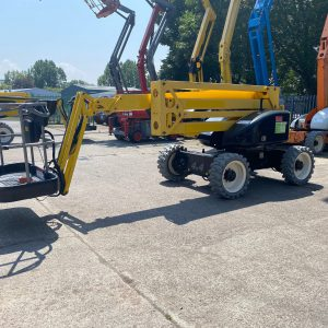 Yellow lifter in yard side on