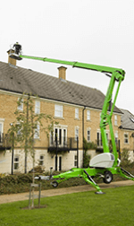 Grey green lifter working on a house